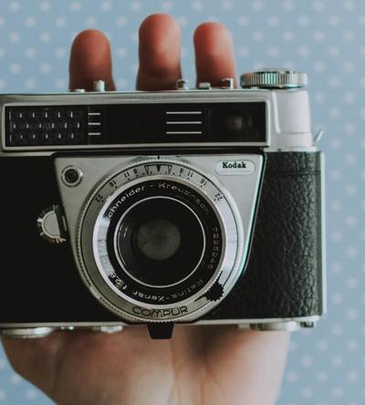 person-holding-black-and-silver-camera-3709089.jpg